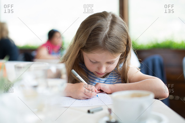 Girl writing note on restaurant tablet