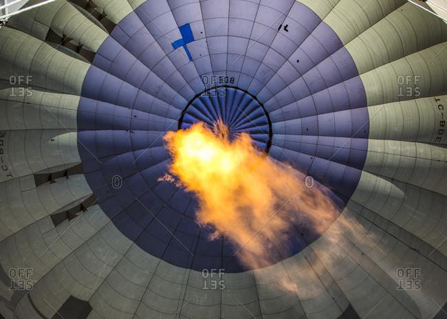 Flame heating air of hot air balloon