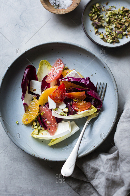 Citrus fruit and chicory ricotta salad with pistachios
