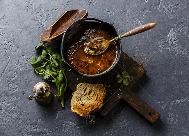 Traditional Georgian soup Kharcho with meat and rice on dark background
