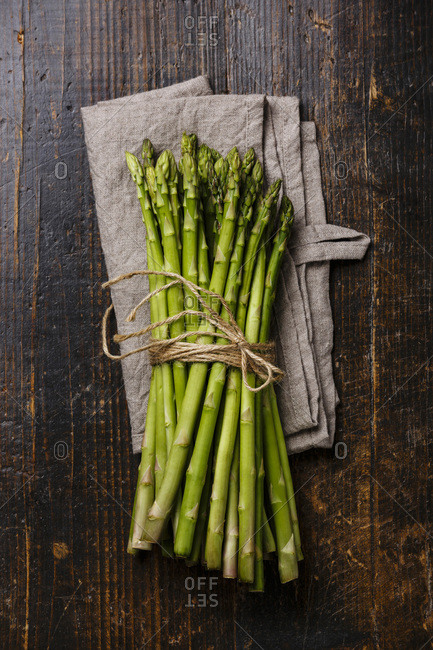 Fresh raw Green asparagus on wooden background