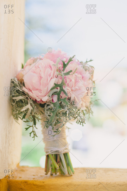 Pink bouquet propped on ledge