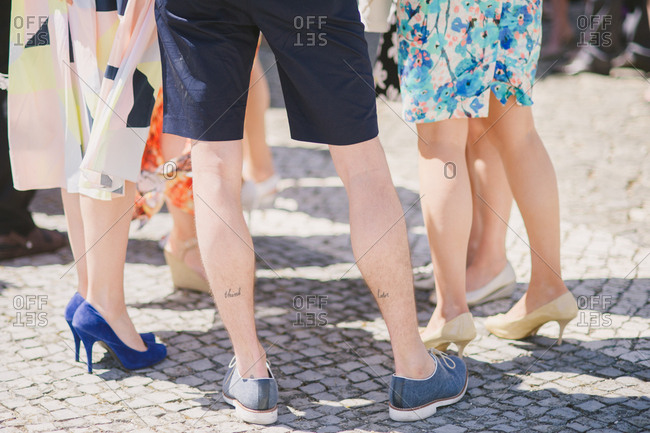 Legs of friends gathered at wedding