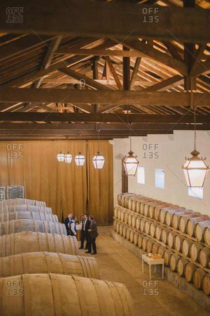 Men inside wine storage hall