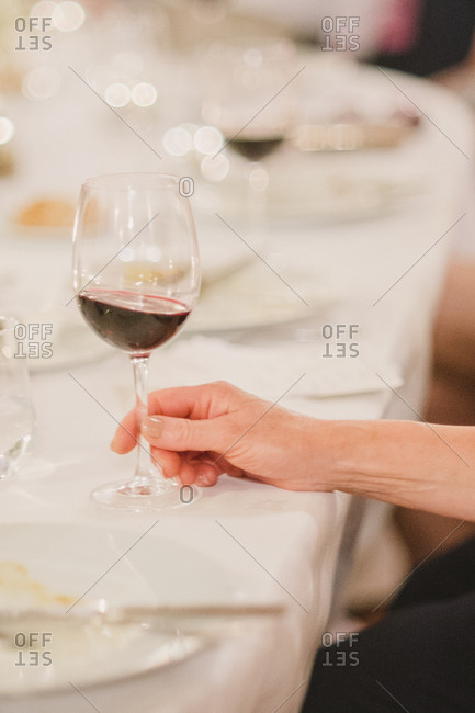 Wedding guest with glass of wine
