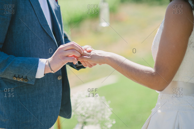 Groom putting ring on bride's finger - Portugal
