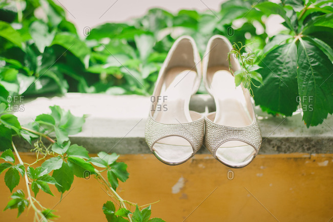 High heeled shoes on ledge