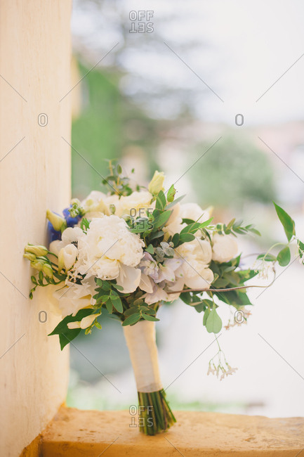 Flower bouquet propped on wall