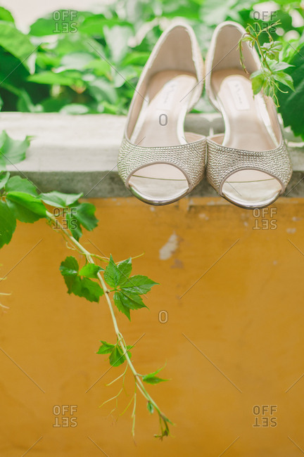 High heeled shoes on a ledge
