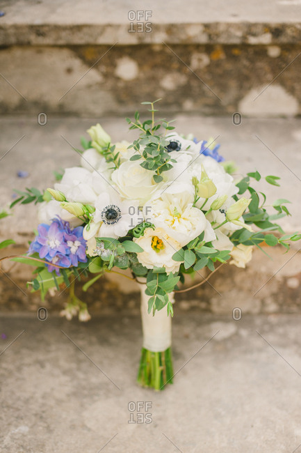 Flower bouquet propped against stone steps