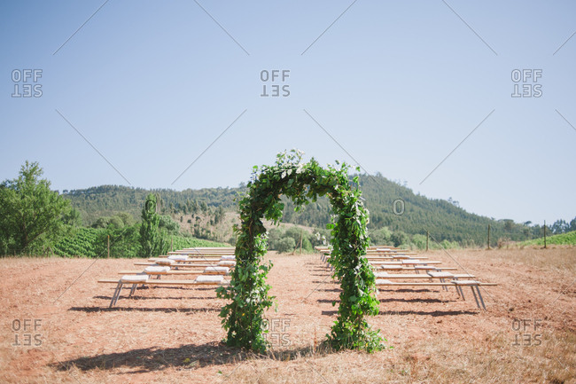 Wedding ceremony setting in vineyard