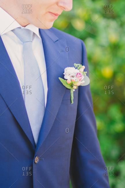 Groom in blue suit outside