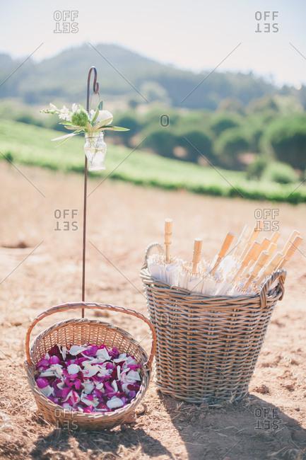 Baskets with petals and umbrellas