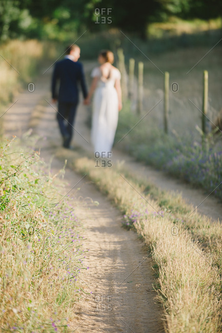 Bridal couple strolling a country path - Portugal
