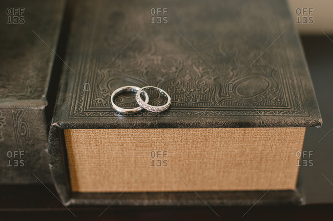 Wedding bands on old book