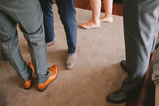 Legs of men getting ready for wedding