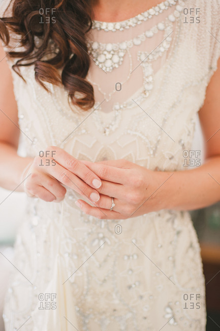 Bride with engagement ring on hand