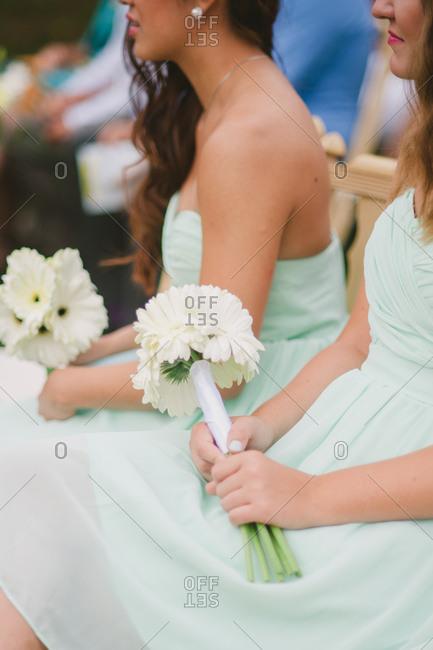 Bridesmaids sitting at a wedding