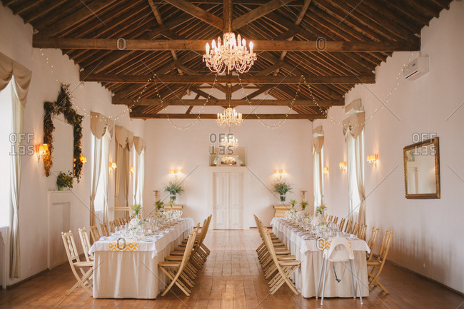 Long tables in wedding reception hall