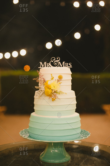 A tiered wedding cake at night