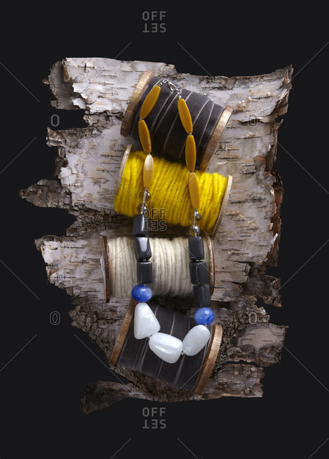 Necklace with spools on bark