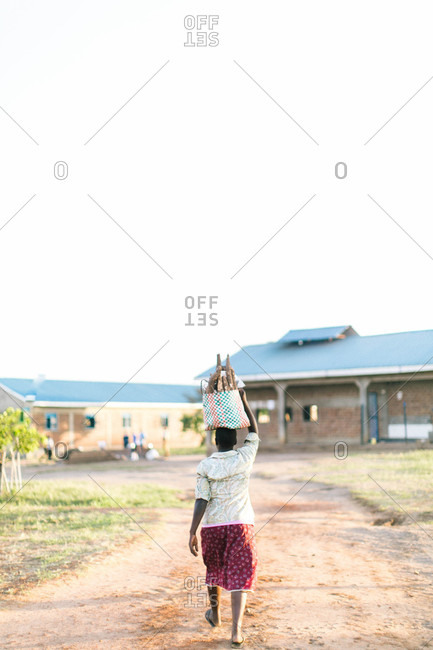 African woman walking with basket on her head