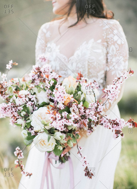 Close up of bride holding large bouquet