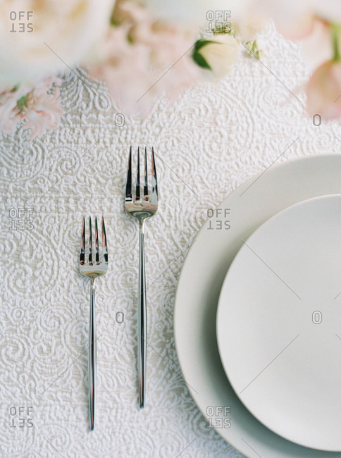 Place setting on table with lace tablecloth