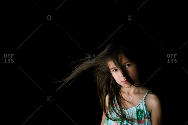 Young girl with wind blown hair