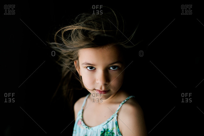 Portrait of young girl with wind blown hair
