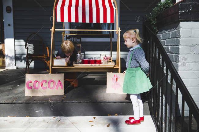 Brother and sister setting up a hot cocoa stand