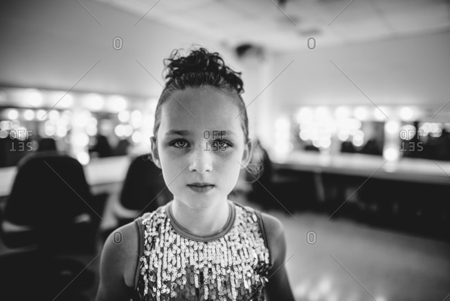 Beautiful young girl in a dance costume backstage in theater