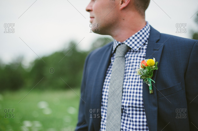Groom's boutonniere pinned to his lapel