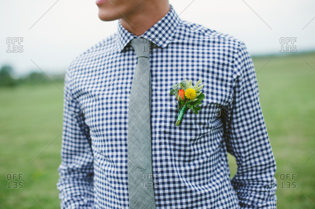 Man in checkered shirt with orange and yellow boutonniere