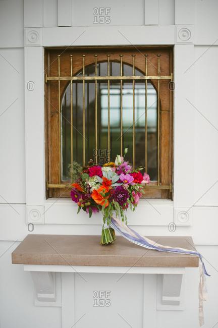 Wedding bouquet at window of church