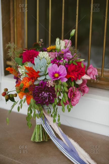 A wedding bouquet with fresh raspberry vines