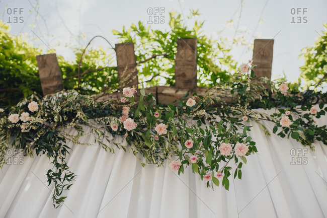 Floral arrangement of pink rose vines at wedding