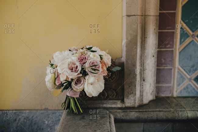 Wedding bouquet of roses on garden fountain