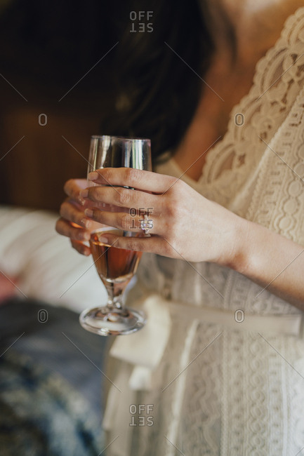 Bride with glass of rose wine