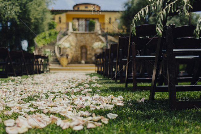 Wedding venue aisle covered in rose petals