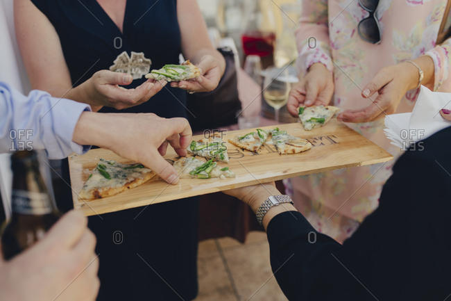 Wedding guests being served hors d'ouvres