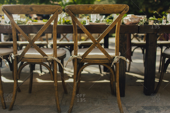 Vintage wooden chairs at dining table