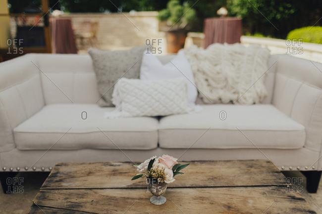 Sofa seating area at garden wedding