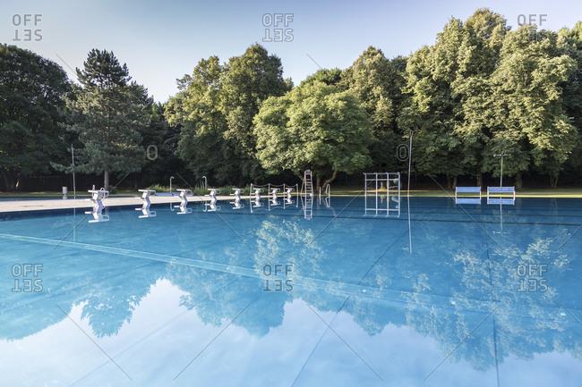 Row of starting platforms at outdoor swimming pool