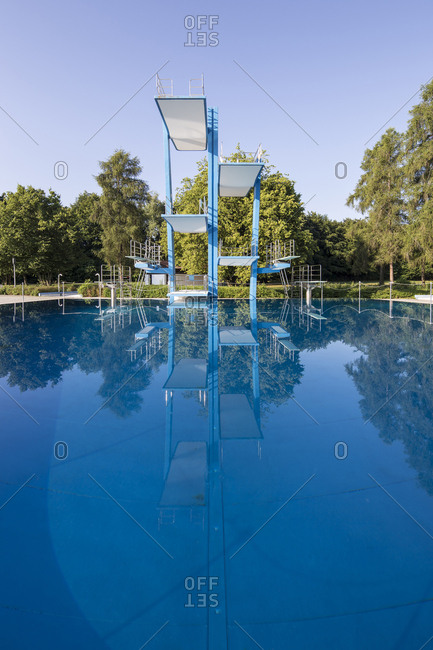 High diving boards and platforms at outdoor swimming pool