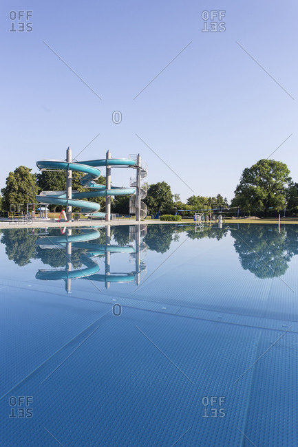 Spiral waterslide at outdoor swimming pool