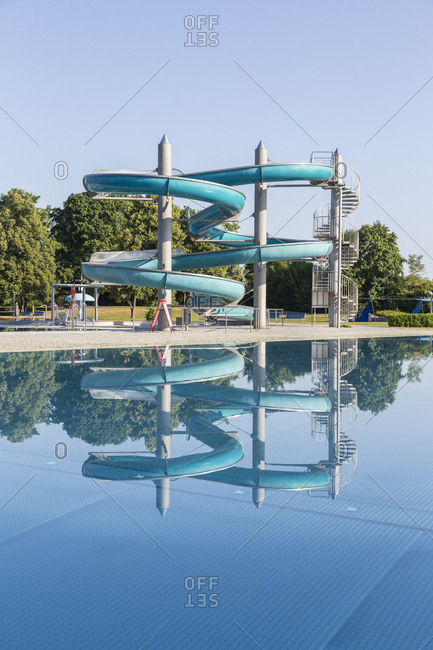 Detail of spiraling waterslides at outdoor swimming pool