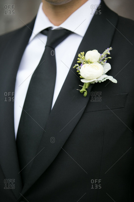 Groom in black tie with boutonniere