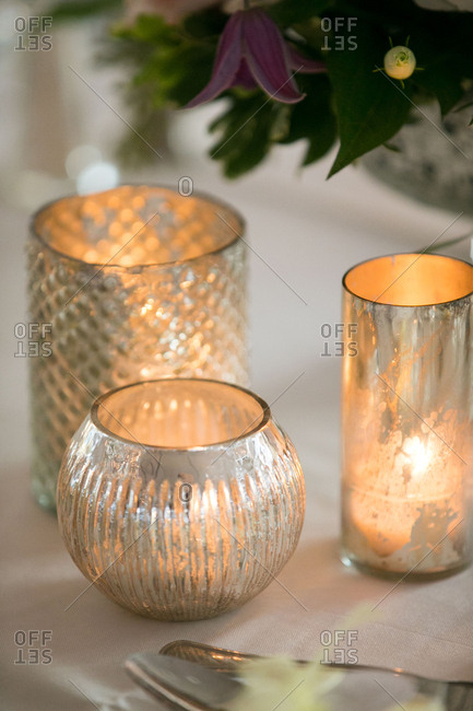 Candles glowing on wedding table