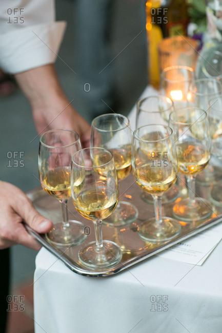 Caterer serving wine at wedding